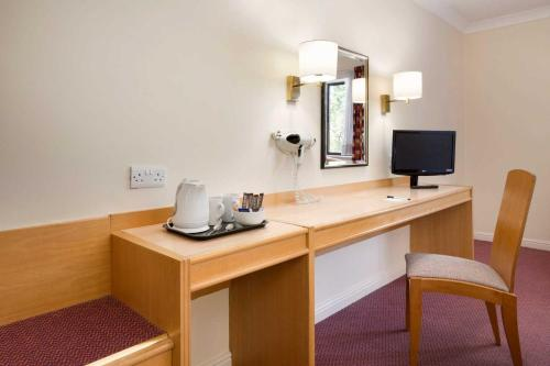 A television and/or entertainment center at Days Inn Southampton Rownhams