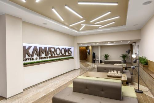 The lobby or reception area at Kamarooms Business Hotel & Spa