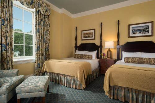A bed or beds in a room at The Otesaga Resort Hotel