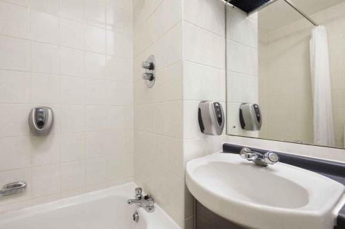 A bathroom at Days Inn Durham