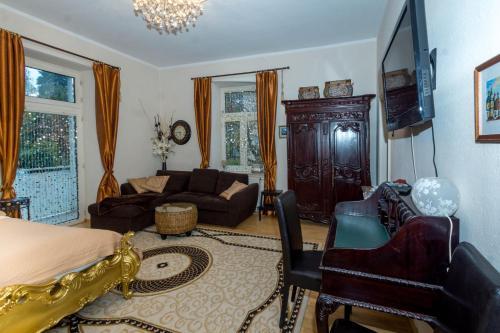 Ein Sitzbereich in der Unterkunft King Luitpold Apartment