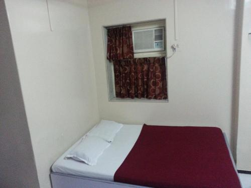 A bed or beds in a room at New Metro Guest House