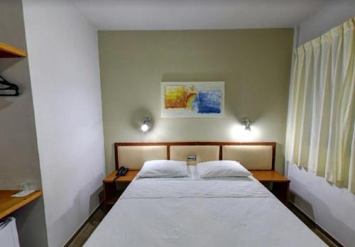 A bed or beds in a room at Ecos Hotel Tourist