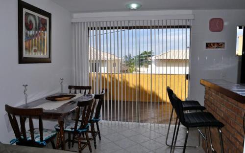 A restaurant or other place to eat at Casa Búzios Praia Rasa
