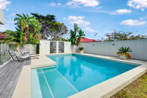 The swimming pool at or near Magnificent Beach House