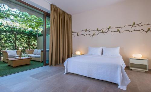 A bed or beds in a room at Club Agia Anna