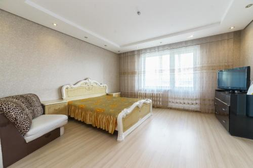 Кровать или кровати в номере Apartment on Gagarina 51