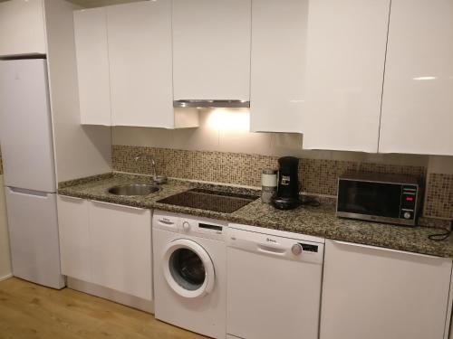 Una cocina o zona de cocina en Apartamento Calle Paz