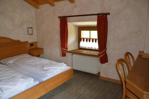 Postel nebo postele na pokoji v ubytování Bait Molin