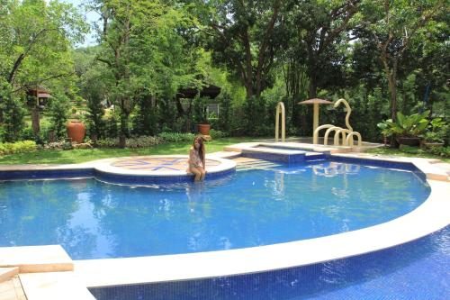 The swimming pool at or near Sophia's Garden Resort