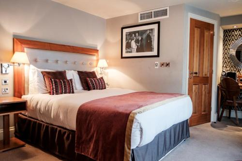 A bed or beds in a room at The Drayton Court Hotel