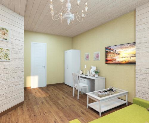 Телевизор и/или развлекательный центр в Aquarius Hotel