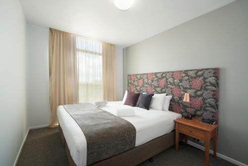 A bed or beds in a room at Quest Flemington
