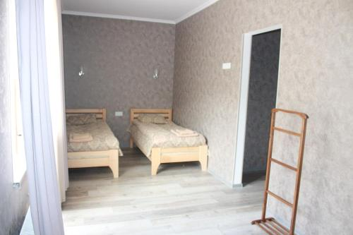 A bed or beds in a room at Hotel Gergeti