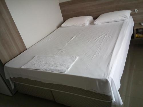 A bed or beds in a room at Hotel Amazon Plazza