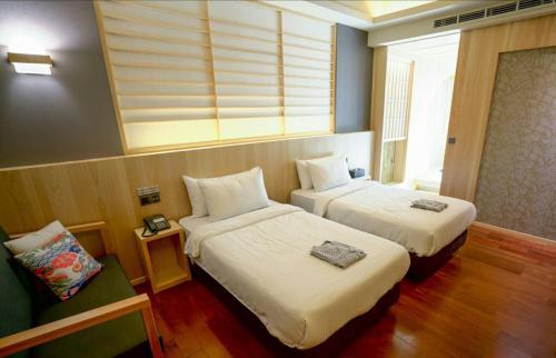 湯悅溫泉會館房間的床