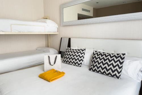 A bunk bed or bunk beds in a room at Petit Palace Triball