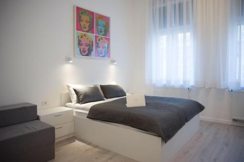 A bed or beds in a room at Barcode Apartments Zrinjevac