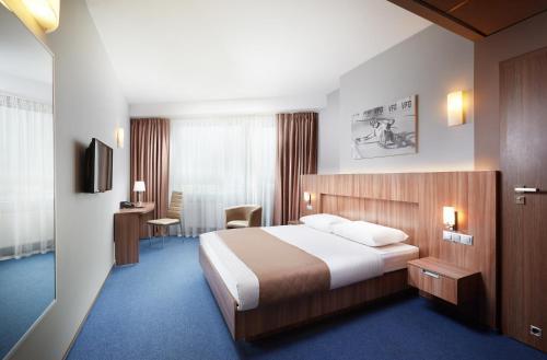 Кровать или кровати в номере Гостиница Славянская