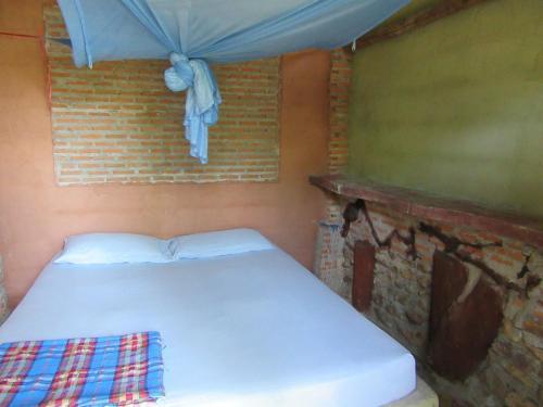 Кровать или кровати в номере Hippy Hut