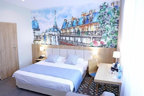 Кровать или кровати в номере ЕВРОПА Отель и Апартаменты