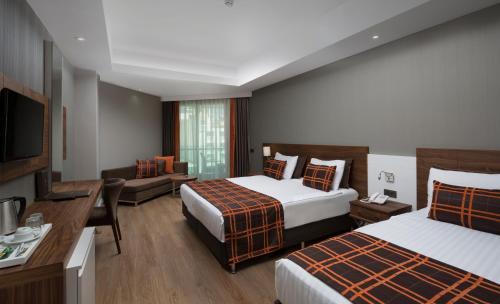 Кровать или кровати в номере Side Sungate Hotel - All Inclusive