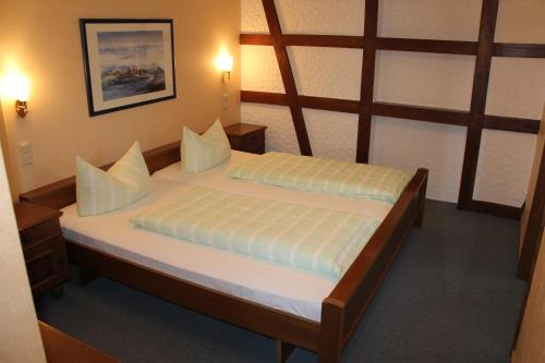 A bed or beds in a room at Landgasthof Schuck
