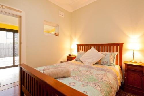 A bed or beds in a room at Taree Apartment