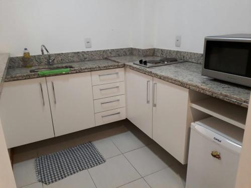 A kitchen or kitchenette at Flat no Prime Residence