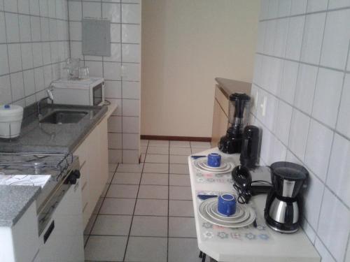 A kitchen or kitchenette at Apart Quartier Latin
