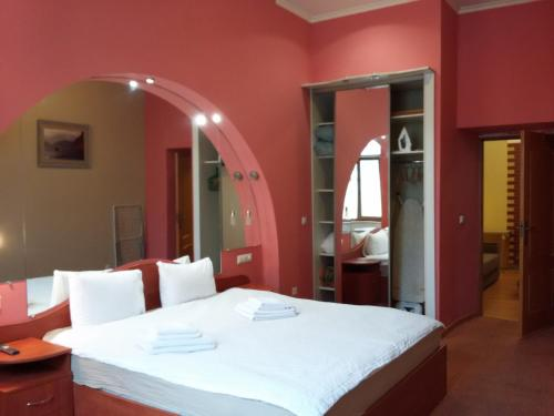 A bed or beds in a room at InLviv Apartments