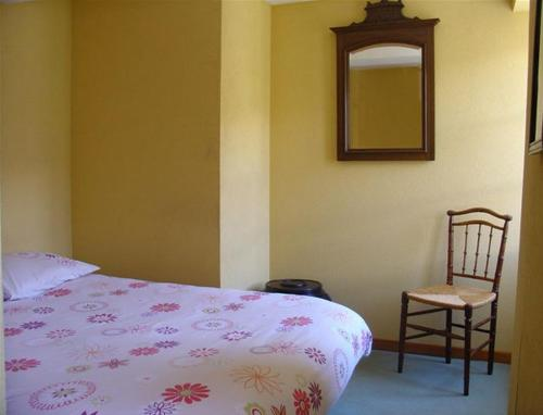 A bed or beds in a room at Auberge de l'Ouzoum
