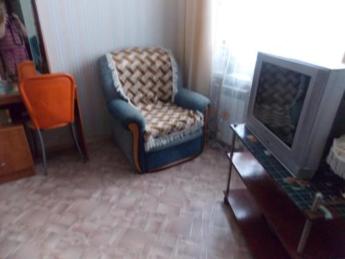 A seating area at Apartment on Gagarina