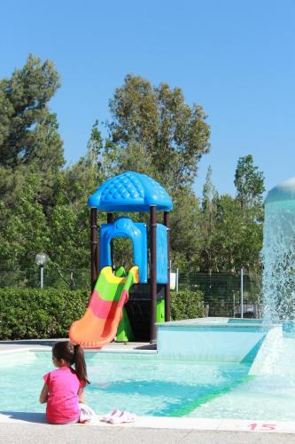 The swimming pool at or near Camping Village Baia del Marinaio