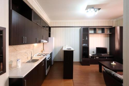 A kitchen or kitchenette at Cozy Apartnents near Hotel Armenia Mariot