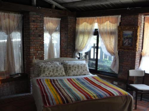 A bed or beds in a room at Jiufen Aromatherapy B&B