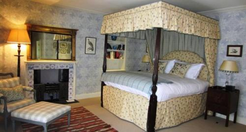 A bed or beds in a room at The Loch Lomond Arms Hotel