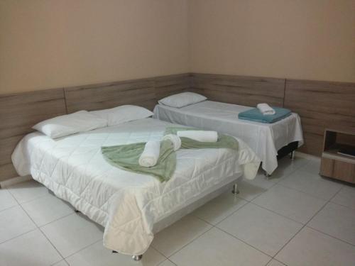 Кровать или кровати в номере Conquista Palace Hotel