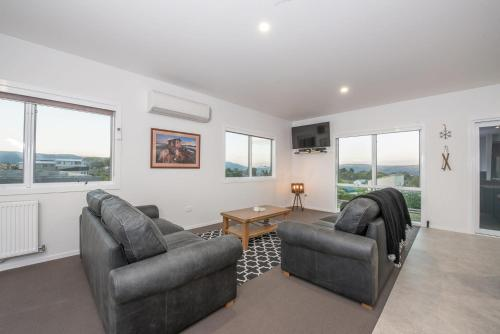 A seating area at Stratton Summit 4- Modern, sophisticated style with lake and mountain views