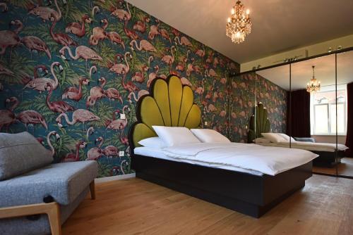 Postelja oz. postelje v sobi nastanitve Tromostovje apartments