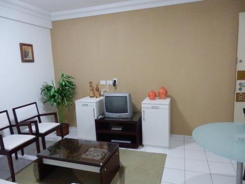 A television and/or entertainment centre at Flat em Boa Viagem - Recife