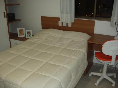 A bed or beds in a room at Flat em Boa Viagem - Recife