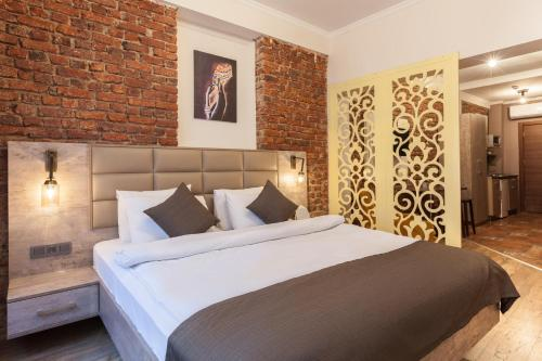 A bed or beds in a room at Beytul Galata Suites