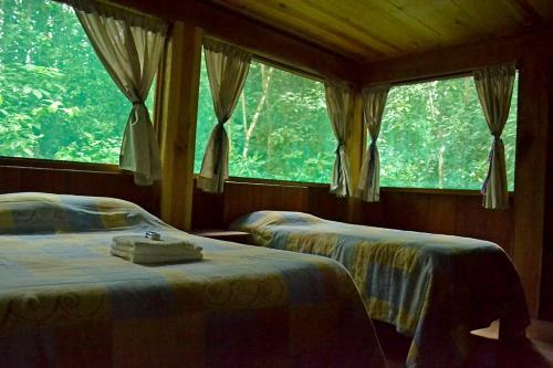 Cama o camas de una habitación en Campamento Rio Lacanja
