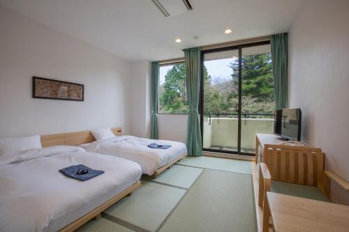 A bed or beds in a room at Hakone Kowakien Miyamafurin