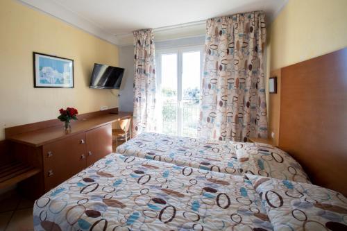 Cama o camas de una habitación en Albergo Hotel
