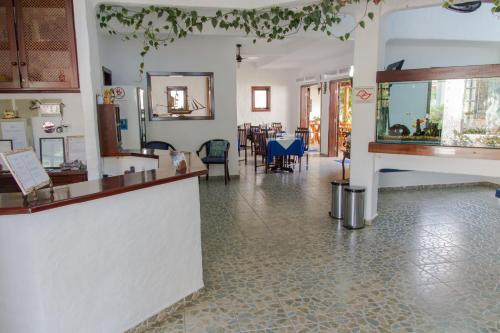 The lobby or reception area at Pousada Torre Del Mar