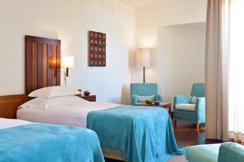Uma cama ou camas num quarto em Pousada Castelo de Alcacer do Sal