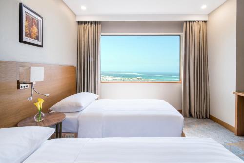 Postelja oz. postelje v sobi nastanitve Hyatt Regency Galleria Residence Dubai