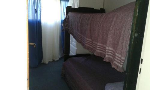 Una cama o camas en una habitación de Departamento La Lliera